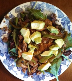 Fajita seasoned ground beef, onion, green pepper and mushroom on a bed of spring greens, garnished with avocado